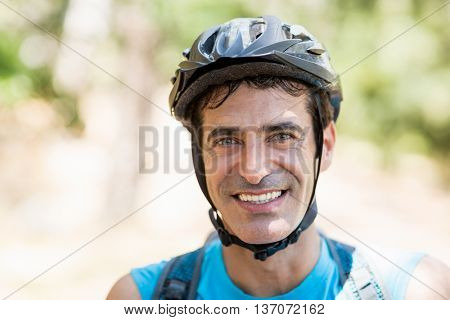 Portrait of a man bike rider smiling on the wood