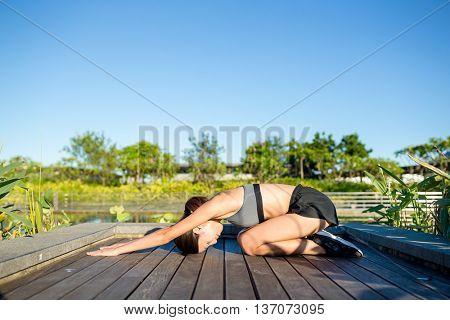 Woman in yoga pose at park