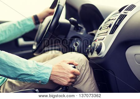 transport, business trip, speed, destination and people concept - close up of young man driving car