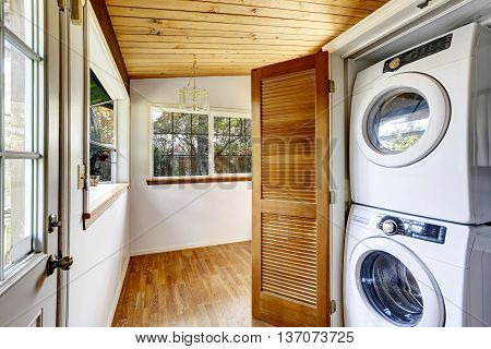 Laundry Room With View To Fenced Back Yard