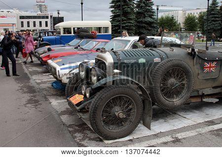 PERM RUSSIA - JUNE 29: Rally of retro-cars Peking-Paris 2016 June 29 2016 in Perm Russia. Cars participating in the rally are near the hotel.