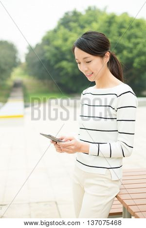 Woman using cellphone at outdoor