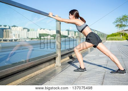 Woman doing warm up exercise