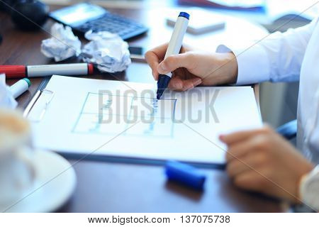 Business woman writing blank The 4 P in office