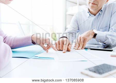 Business People Negotiating A Contract