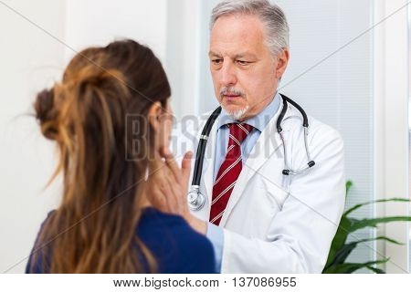 Doctor checking the lymph nodes size of a patient