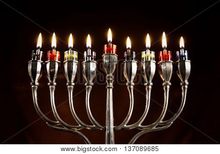 Jewish Holiday Hanukkah With Silver Menorah (traditional candelabra) with Burning candles