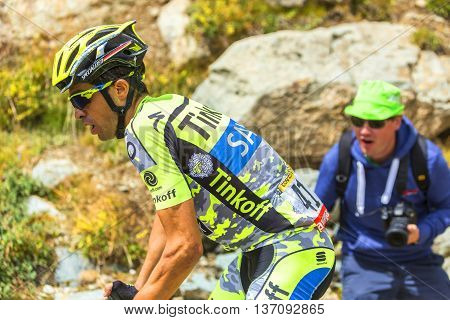 Col de la Croix de Fer France - 25 July 2015: Profile of Alberto Contador of Thinkoff Saxo Team in full effort climbing to the Col de la Croix de Fer in Alps during the stage 20 of Le Tour de France 2015.