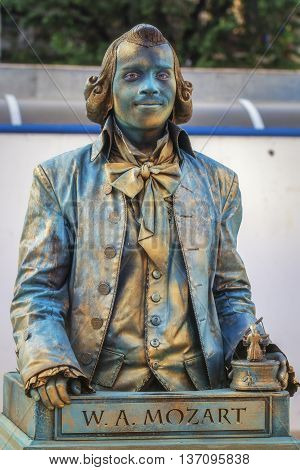Bucharest ,Romania - June 10, 2016: W.A Mozart living statue at B-FIT in the Street. B-FIT is a cultural event that involves international artists and acrobats who act in theater plays on street.