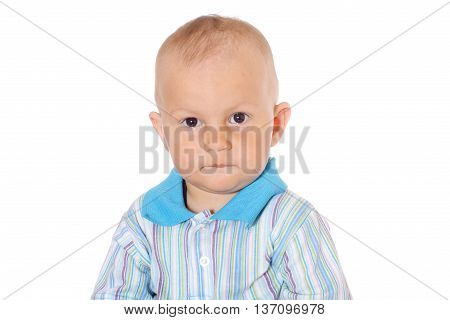 serious little baby boy on white background
