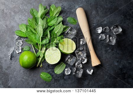 Mojito cocktail making. Mint, lime, ice ingredients and bar utensils. Top view