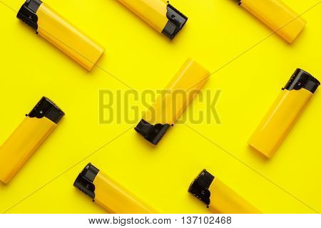 disposable plastic lighters on the yellow background
