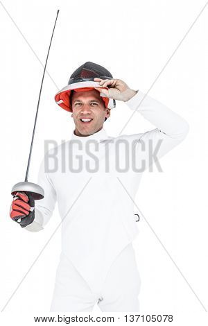 Portrait of man wearing fencing suit practicing with sword on white background