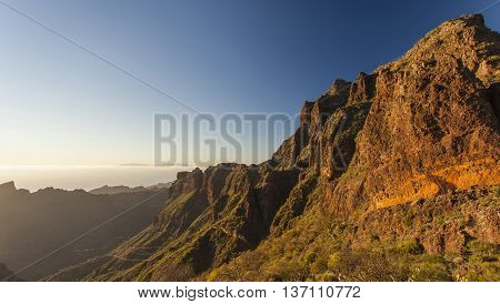Mountain ridge on the Canary Islands which is lit with the evening sun