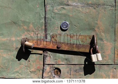 The old iron door with rusty locks