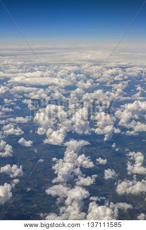 View from a plane window to Earth and clouds