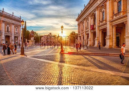 Rome, Italy - June 18, 2016: sunset in the Campidoglio square on the Capitoline Hill, Mons Capitolinus, one of the seven hills of Rome. Designen by artist Michelangelo in Renaissance age