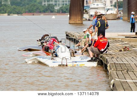 Madison Indiana - July 2 2016: Boats line up at the dock before a Grand National Hydroplane qualification heat at the Madison Regatta in Madison Indiana July 2 2016.