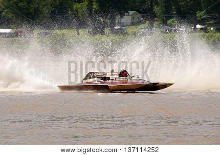 Madison Indiana - July 2 2016: Steve Kuhr II drives the GNH 317 in the Grand National Hydroplane Qualification Heat #1 at the Madison Regatta in Madison Indiana July 2 2016.