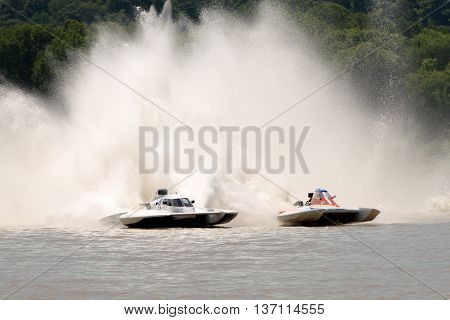Madison Indiana - July 2 2016: Kevin Kreitzer in the GNH 515 and Scott Liddycoat in the GNH 18 race in the National Modified Saturday qualification heat #2 at the Madison Regatta in Madison Indiana July 2 2016.