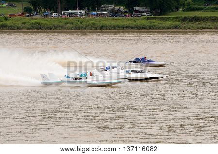 Madison Indiana - July 2 2016: Drivers racing in the Grand National Hydroplane Final at the Madison Regatta in Madison Indiana July 2 2016.