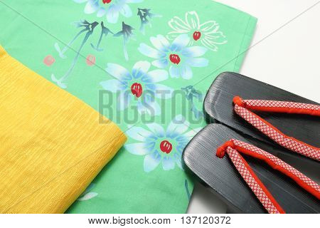 Japanese yukata, obi, and sandals. Concept of Japanese summer.