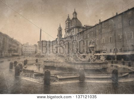 Aged vintage image of the Neptune Fountain, Rome and the Piazza Navona with staining and discoloration for retro travel themes
