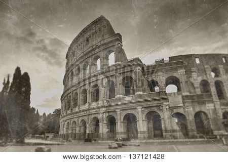 Retro tone mapped aged image of the Roman Colosseum amphitheatre in sepia tones for vintage travel and sightseeing concepts