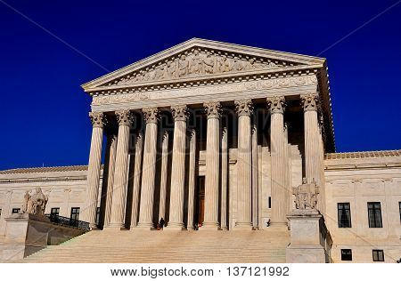 Washington DC - April 12 2014: The imposing neo-classical facade with Corinthian columns and bas relief pediment of the U. S. Supreme Court *