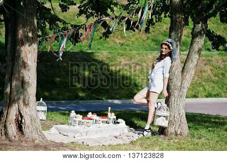 Unmarried Girl With Veil On Had Posed Background Picnic Table And Decor At Bachelorette Party