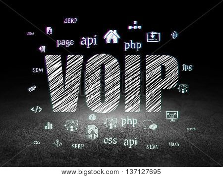 Web design concept: Glowing text VOIP,  Hand Drawn Site Development Icons in grunge dark room with Dirty Floor, black background