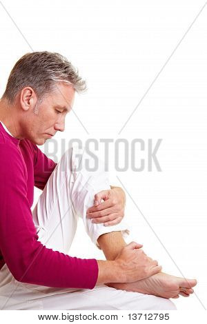 Elderly Man Massaging His Feet