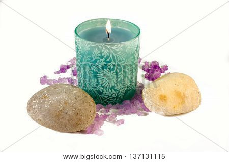 Green candle with purple aromatic sea salt