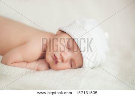 beautiful newborn sleeping baby girl. close-up portrait