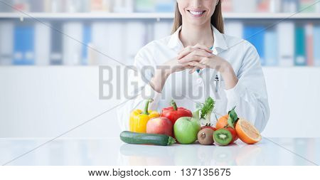 Smiling Dietician With Healthy Vegetables