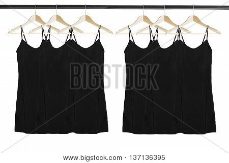 Group of same black silk dresses on wooden clothes racks isolated over white