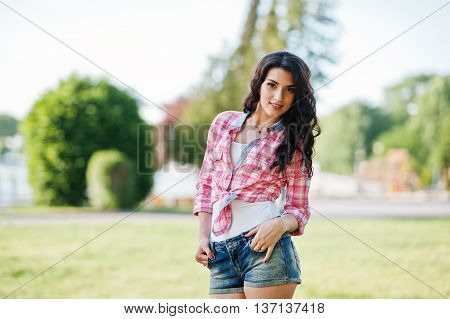 Portrait Of Style Country Girl On Short Jeans Shorts And Crosscountry Checkered Line Shirt