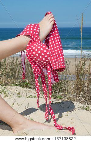 Woman Showing Her Waxed Legs With Bikini On It