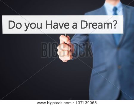 Do You Have A Dream ? - Businessman Hand Holding Sign