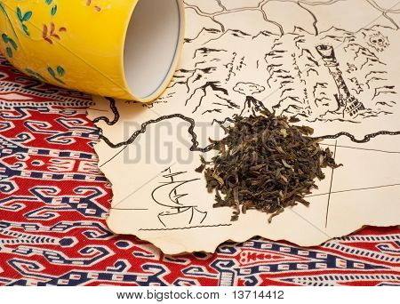 Treasure map, tea and a tea cup
