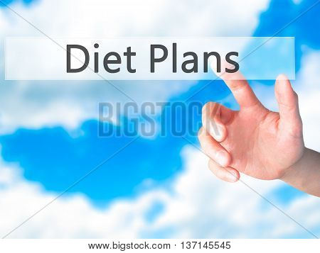 Diet Plans - Hand Pressing A Button On Blurred Background Concept On Visual Screen.