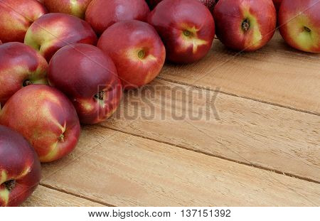 semicircle of nectarines on the wooden boards