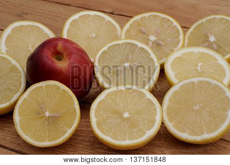 lemon and nectarine on the wooden boards