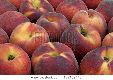 red tasty peaches next to each other