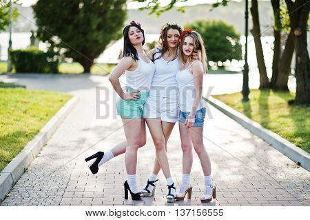 Three Happy And Sexy Girls On Short Shorts And White Shirts Posed On Road At Park On Bachelorette Pa