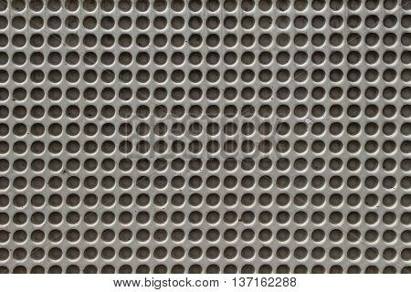Perforated concrete background
