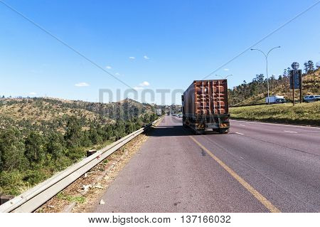 Heavy duty container truck travelling along highway between Durban and Gauteng in South Africa