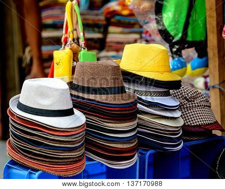 Group of colorful hats at a market stall, India