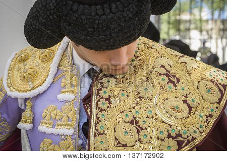 Baeza SPAIN - August 15 2009: Spainish bullfighter Sebastian Castella putting itself the walk cape in the alley before going out to bullfight typical and very ancient tradition in Baeza Jaen province Spain
