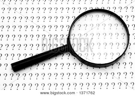 Magnifying Glass And Question Marks